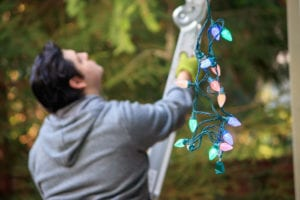 Roofing Companies Hanging Christmas Lights