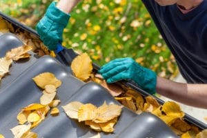 clogged gutter roofing cleaning professional